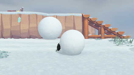 Snowball pushed by dung beetle.jpg
