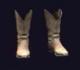 Поношенные традиционные ковбойские сапоги